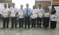 Dinas PMD Mesuji dan Desa Hadi Mulyo Terima Penghargaan dari KPP Pratama Kotabumi